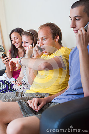 Group of young people on the phone