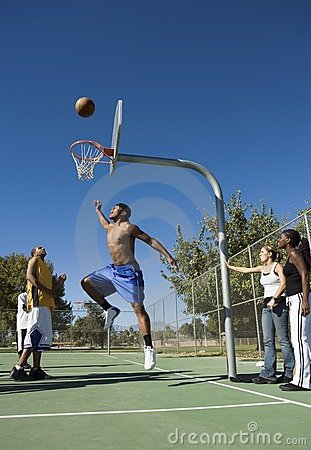 Group of young people playing basketball