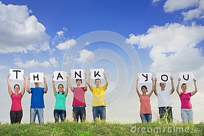 Group of young people spelling thank you