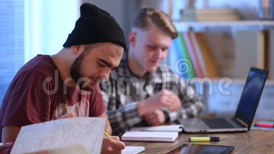 Group of young students studying together at home stock footage