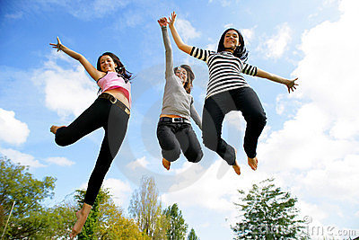 Group of young women jumping