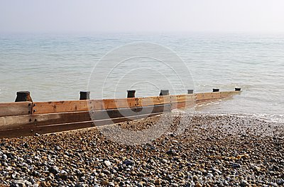 Groyne on shingle beach. UK