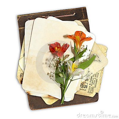 Grunge album with paper stack and flowers