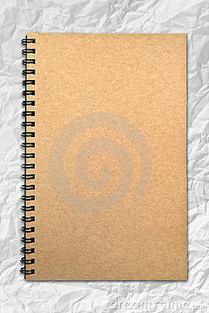 Grunge brown cover notebook on wrinkled paper