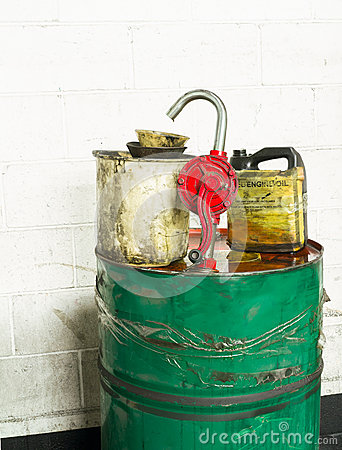 Grunge dirty oil drum, spout and buckets.