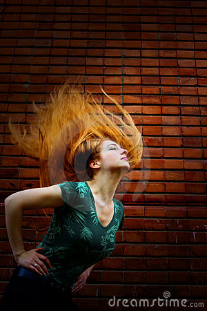 Grunge fashion shot of woman with motion hair