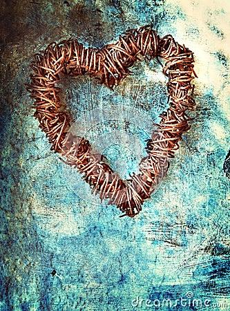 Grunge heart on blue wall
