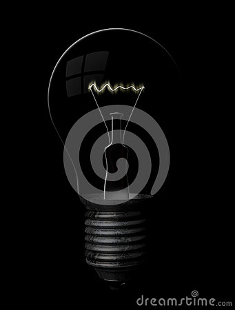 Grunge lightbulb on black background