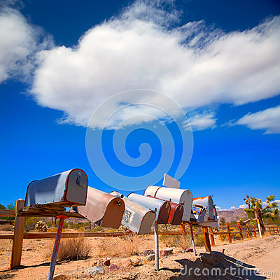 Free Grunge Mail Boxes In A Row At California Mohave Desert Stock Photo - 35767910