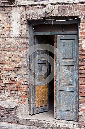 Grunge masonry house doors brick wall background