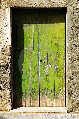 Grunge old green door