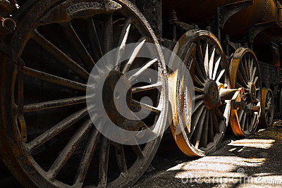 Grunge old steam locomotive wheels