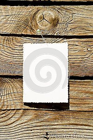 Grunge paper on wood plank