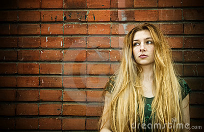 Grunge portrait of sad young woman