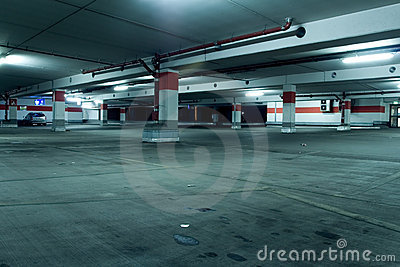 Grunge underground parking garage with car
