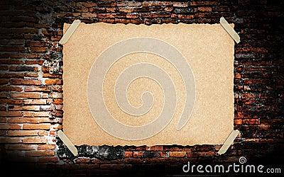 Grunge vintage old Brown paper on brickwall