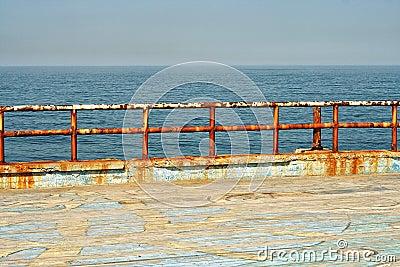 Grungy metal railings at the sea