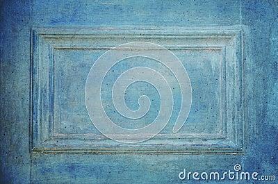 Grungy old blue door closeup