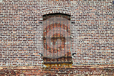 Grungy Old Bricked Up Window With Rusty Bars
