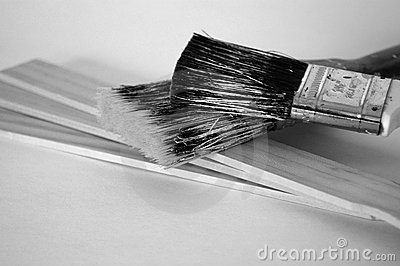 Grungy Paintbrushes on Paint Stirrers