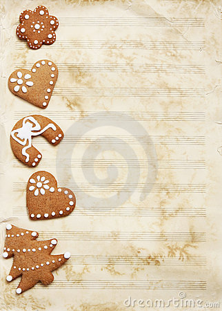 Free Grungy Sheet Music Paper With Christmas Cookies. Stock Image - 22582861