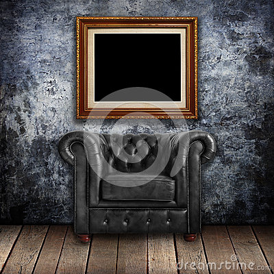 Free Grungy Wall With Classic Brown Leather Armchair And Gold Frames Stock Images - 26118614
