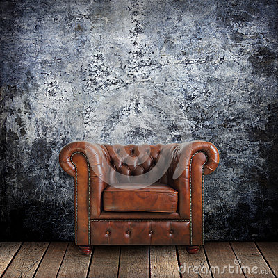 Free Grungy Wall With Classic Brown Leather Armchair And Old Wood Royalty Free Stock Image - 26118736