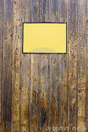 Grungy wood texture with a yellow sign
