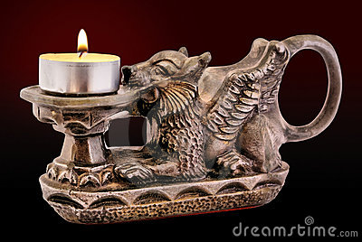Gryphon candle holder with candle