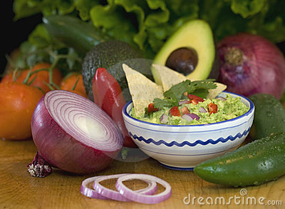 Guacamole, chips and fresh vegetables
