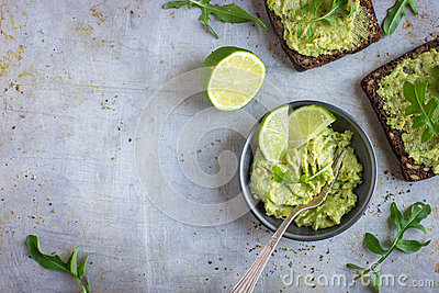 Guacamole And Rye Toasts On Rustic Background Stock Photo - Image ...