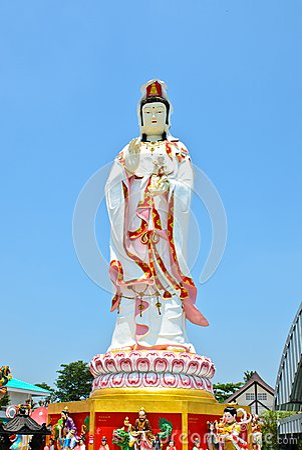 Guan Yin statue on blue sky background