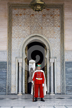 Guard in front of the Mausoleum of Mohamed V Editorial Photo