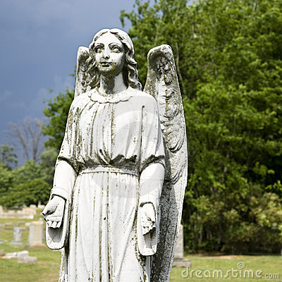 Guardian angel statue in graveyard.