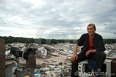 Guest-worker sits at the dump Editorial Stock Image