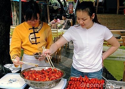 Guilin, China: Women Cooking Shrimp Editorial Stock Photo