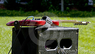 Guitar on amp in grass