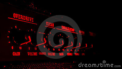 Guitar amplifier control panel in red light