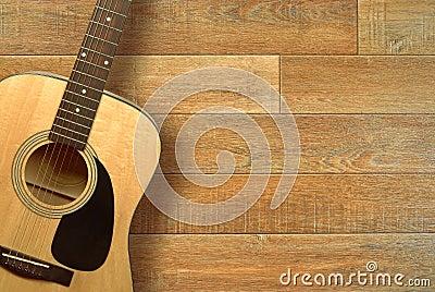 Acoustic guitar on floor
