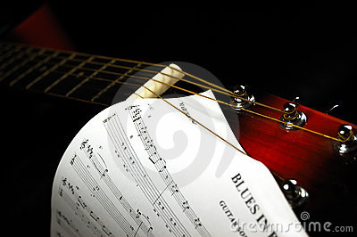 Guitar headstock with a blues sheet music