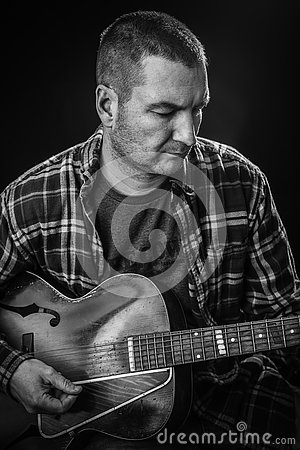 Guitar Hero - Man Playing Old Acoustic Guitar 3