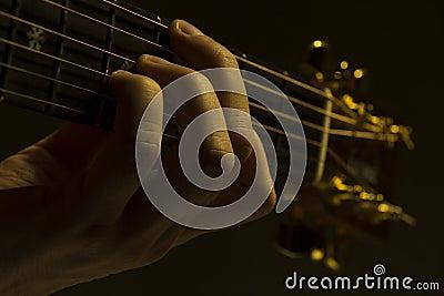 Guitar neck under dramatic light