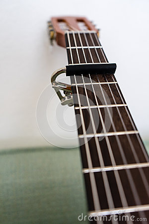Free Guitar Neck With Capo Low Angle View Close Up Royalty Free Stock Images - 99123489