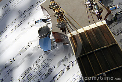 Guitar over song book