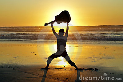 Guitar player on the beach
