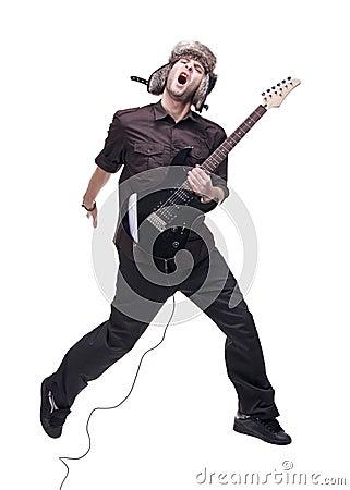 Guitar player jumping in midair