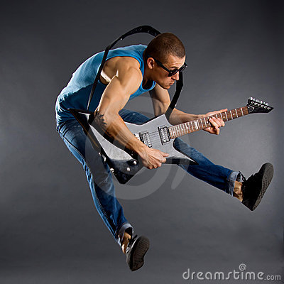 Free Guitar Player Jumps Royalty Free Stock Photo - 15590255