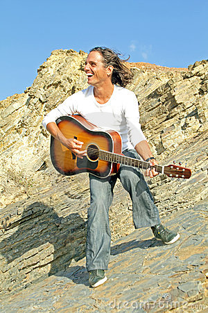 Guitar player on the rocks