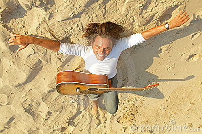Guitar player in the sand
