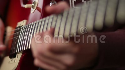 Guitar player using tapping technique stock video footage